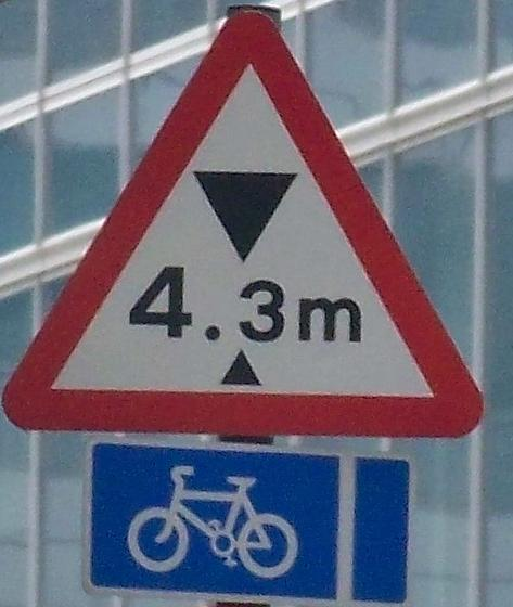 Metric height warning sign