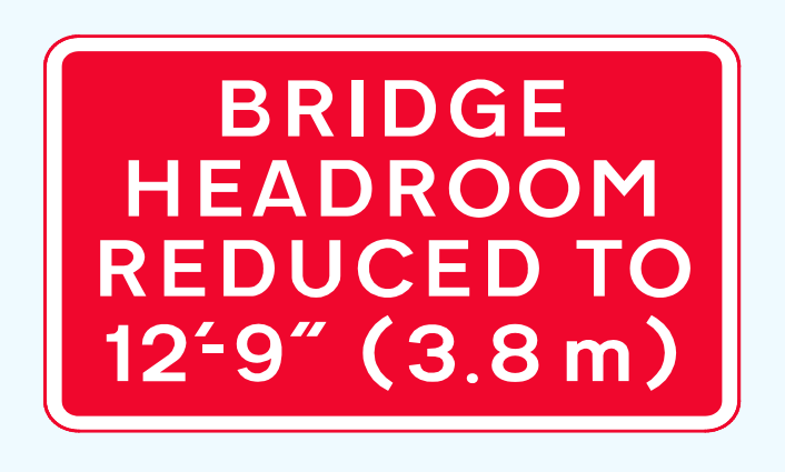 Dual bridge headroom sign
